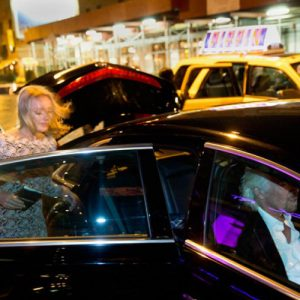 Helen Clarke with Sir Richard Branson sitting shotgun, as he prefers, on their way to the Endeavor awards in Midtown Manhattan. Next stop? Jamaica. Photo by Gus Powell, taken in November 2013.